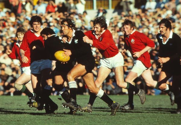 Rugby Union - 1977 British Lions Tour to New Zealand - New Zealand Maoris 19 British Lions 22 Trevor Evans attempts to halt the All Black charge at Eden Park, Auckland