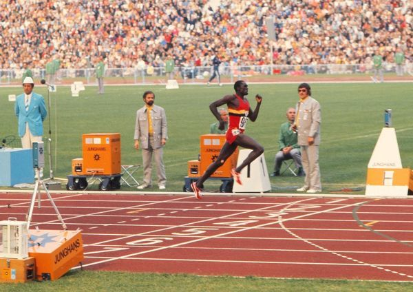 Athletics - 1972 Munich Olympics - Men's 400m Hurdles Final Uganda's John Akii Bua wins the gold medal in a new World Record of 47.82 in the Olympiastadion, Munich, West Germany. He was Uganada's first Olympic Champion
