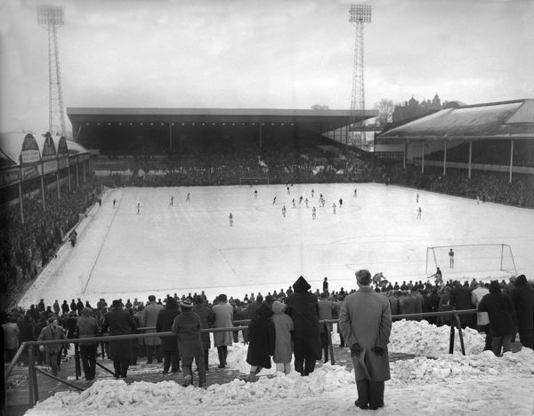 Playing in the snow:  View of Aston Villa Football club's Villa Park football ground December 1963  Football Credit : Colorsport