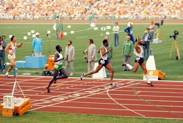 Athletics - 1972 Munich Olympics - Men's 400m Final USA's Vince Matthews (#999;right) wins the race in 44.66 with compatriot Wayne Collett (#978) second in 44.80 in the Olympiastadion, Munich, West Germany. Third is Kenya's Julius Sang (#587)
