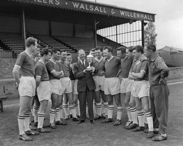 Walsall Champions Div 4 1960 : Walsall team with Manager William Moore and the Division 4 Championship trophy 1959 / 60 season Credit : Colorsport