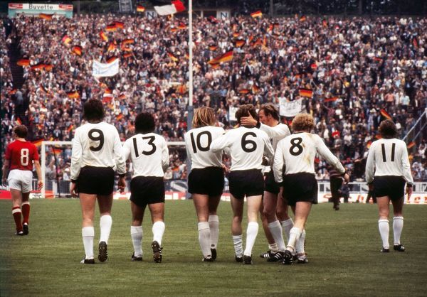Football - 1972 UEFA European Football Championship - Final: West Germany 3 Soviet Union 0 West Germany's Herbert Wimmer is congratulated after scoring his side's second goal in the Heysel Stadium, Brussels. From left to right: Josef Heynckes (#9)