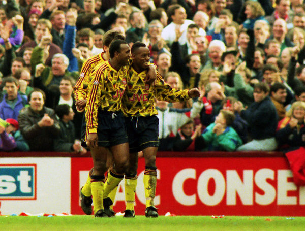 Football - 1991 / 1992 First Division - West Ham United 0 Arsenal 2     Arsenal's David Rocastle celebrates with goalscorer Ian Wright, at Upton Park.     14/03/1992