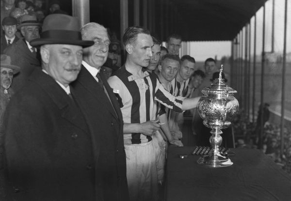 Football - 1932 / 1933 season West Bromwich Albion reserve team captain Abel Robert 'Bob' Finch receives the Central League trophy from William Cuff, Everton Chairman and founder of the Central League