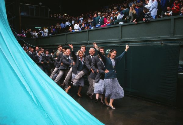 TENNIS  Umpires and Officials let their hair down and do the 'Conga' in the rain on Centre Court  Wimbledon Tennis Championships 1992  CREDIT : COLORSPORT /ANDREW COWIE