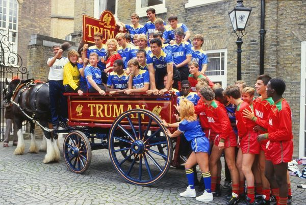 Wimbledon team on the Horse and cart at the Truman Brewery for their Pre Season Photocall 02/08/1986. Dave Beasant and Manager Bobby Gould, Wally Downes and Vinny Jones (far left). 1986/87 Credit : Colorsport / Andrew Cowie