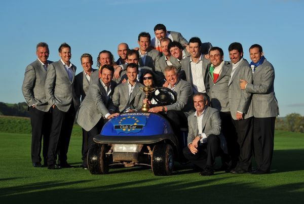 Golf - Ryder Cup 2010 - Day 4, Singles The Europe team pose with one of their golf carts and the Ryder Cup trophy at Celtic Manor, Newport