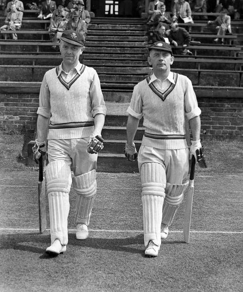Cricket - 1953 season Winston Place, left, and Cyril Washbrook walk out to bat for Lancashire