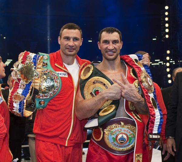 Boxing - WBA IBO WBO Heavyweight Unification Fight - Wladimir Klitschko vs. David Haye  Vitali (left) and his brother Wladimir Klitschko with their World Title Belts