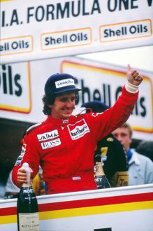Alain Prost celebrates winning his first world title in 1985