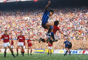 Alessandro Altobelli and Mark Hateley compete in the air during the Milan Derby in 1984