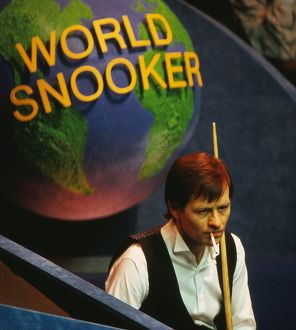 Alex Higgins has a cigarette at the 1987 Embassy World Snooker Championship