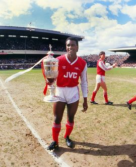 Arsenal's David Rocastle celebrates with the Littlewoods Challenge Cup in 1987