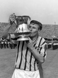 Aston Villa captain Johnny Dixon kisses the FA Cup in 1957