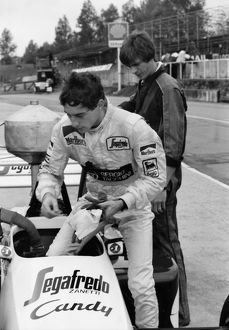 Ayrton Senna gets into his Toleman-Hart Car during practice for the 1984 British