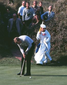 Bernard Hunt putts during the 1969 Ryder Cup