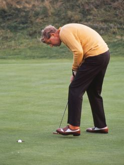 Bernard Hunt sinks a putt during the 1969 Ryder Cup