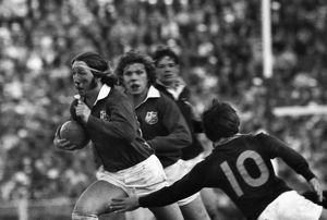 A bloody JPR Williams makes a break for the British Lions