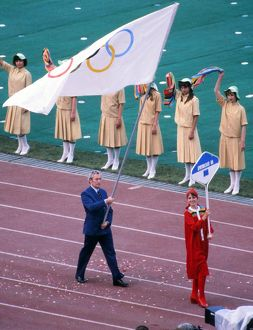 BOA official Dick Palmer carries the Olympic flag for Great Britain during the Opening
