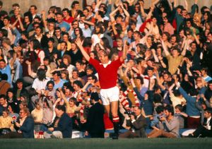 Bobby Charlton celebrates his side's goal in his last home game for Manchester United.