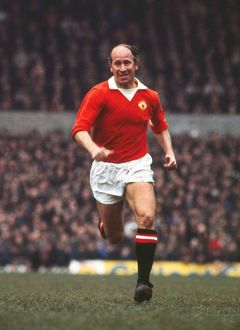 Bobby Charlton playing in his last home game for Manchester United.
