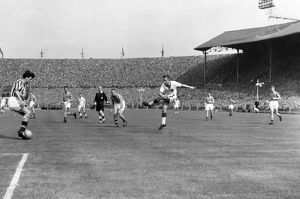 Bobby Charlton shoots during the 1957 FA Cup Final