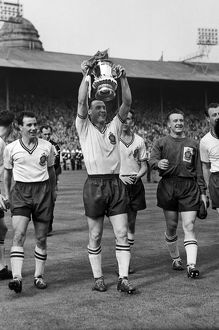 Bolton captain Nat Lofthouse parades the trophy after victory in the 1958 FA Cup Final