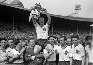 Bolton Wanderers captain Nat Lofthouse is chaired by his teammates after victory