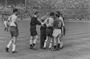 Bolton's Dennis Stevens is helped to his feet after lying injured - 1958 FA Cup Final