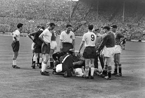 Bolton's Dennis Stevens receives medical attention - 1958 FA Cup Final