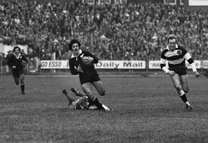 Bryan Williams makes a break for the All Blacks against the Barbarians in 1973