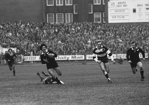 Bryan Williams makes the break for Grant Batty's try against the Barbarians in 1973