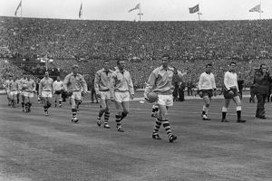 Burnley captain Jimmy Adamson leads his side out for the 1962 FA Cup Final
