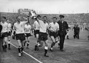 Cliff Jones and Jimmy Greaves parade the FA Cup around Wembley after Spurs' victory