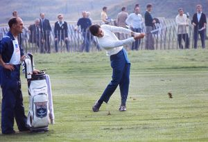 Dave Hill hits from the fairway at the 1969 Ryder Cup