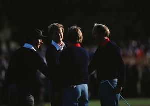 Europe's Mark James and Sandy Lyle shake hands with the USA's Ben Crenshaw