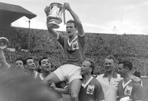 Forest captain Jack Burkitt lifts the trophy - 1959 FA Cup Final