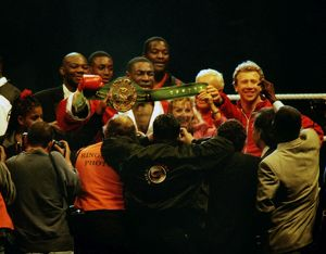 Frank Bruno celebrates winning the WBC title after defeating Oliver McCall