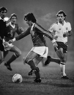 George Best on the ball for Ipswich while England's Ray Wilkins looks on