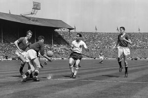 Harry Gregg fields the ball under pressure from Nat Lofthouse in the 1958 FA Cup Final