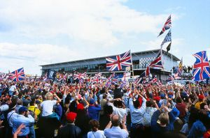 + The home fans celebrate Nigel Mansell's win at the 1992 British Grand Prix