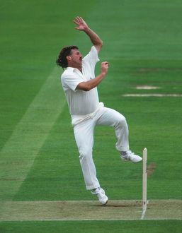 Ian Botham bowls for England in 1992