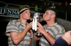 The Innes Brother kiss the Bowring Bowl after Cambridge's victory in the 1998
