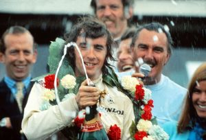 Jackie Stewart celebrates winning the 1969 British Grand Prix.