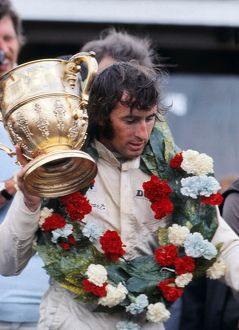 Jackie Stewart with the trophy after winning the 1969 British Grand Prix.