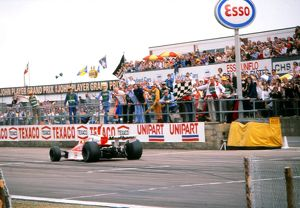 James Hunt crosses the line to win the 1976 British Grand Prix.