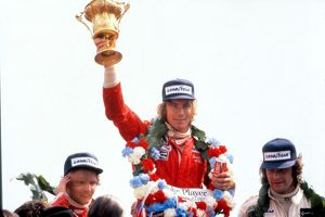 James Hunt lifts the trophy after winning the 1976 British Grand Prix.