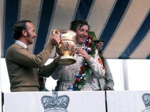 Jochen Rindt is awarded the trophy after winning the 1970 British Grand Prix.