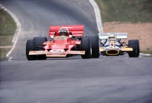 Jochen Rindt and Jack Brabham approach 'Druids' at the 1970 British Grand Prix at Brands Hatch