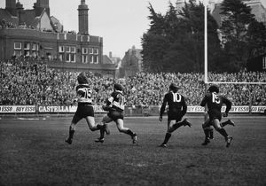John Bevan runs with the ball for the Barbarians against the All Blacks in 1973